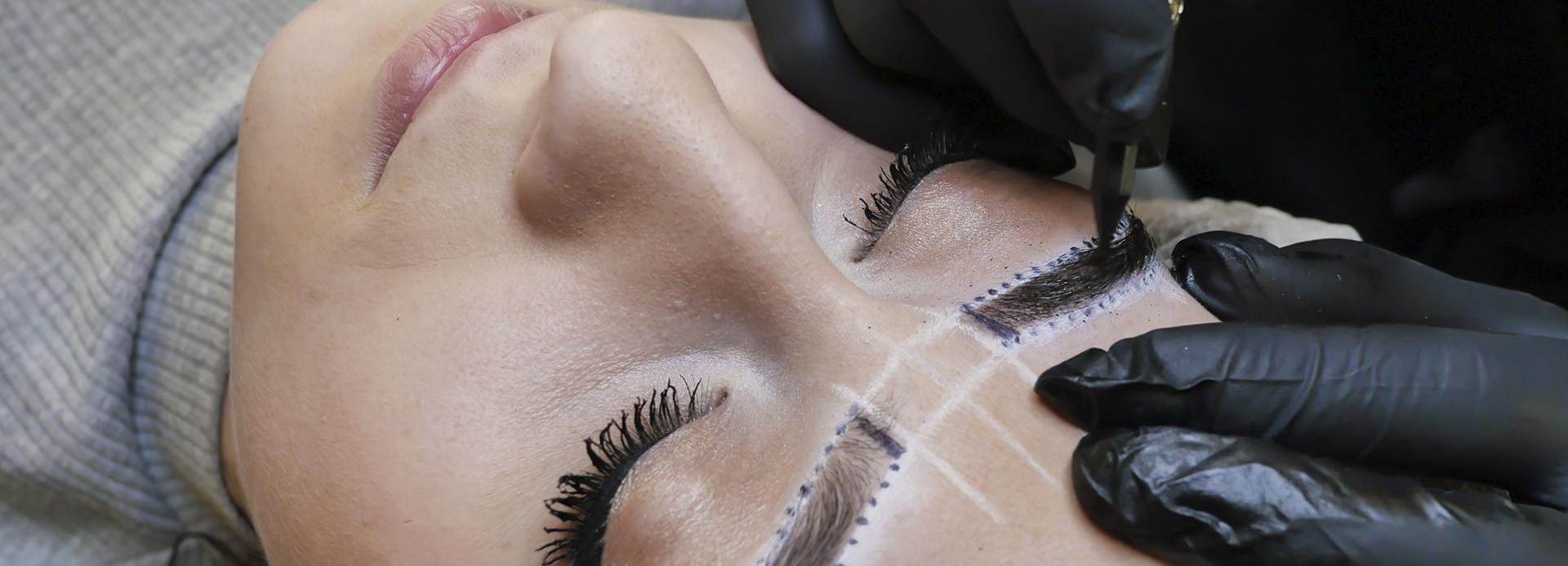 Woman getting elite eyebrows done